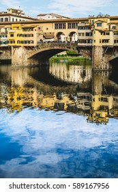 Ponte Vecchio Bridge in Florence with a nice reflection on the river Arno.