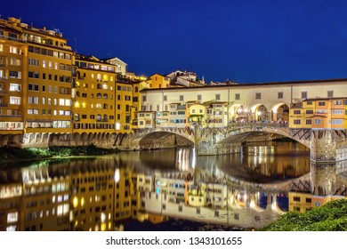 Ponte Vecchio in Florence, Italy, on a summer night. Colorful travel background, blue hour.