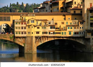 Ponte Vecchio (Old Bridge), famous stone bridge with shops built along it, during the sunset, Florence, Tuscany, Italy.