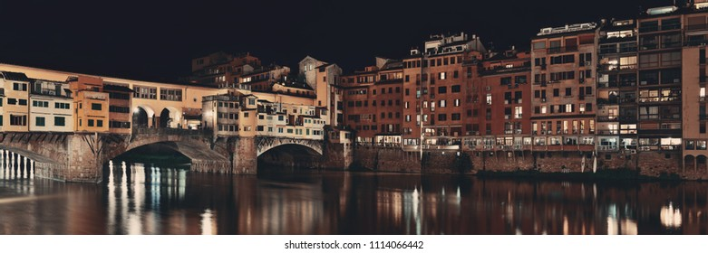 Ponte Vecchio over Arno River panorama in Florence Italy at night.