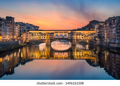 Ponte Vecchio over the Arno river in Florence at night, Italy