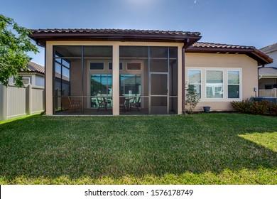 Ponte Vedra Beach, Florida / USA - November 29 2019: Backyard with screened in patio