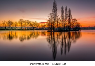 Pontefract Park Lake near Wakefield, sunrise reflections near Pontefract Racecourse, West Yorkshire, UK