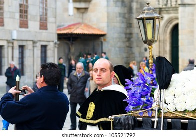 PONTEVEDRA - APRIL 5: Cofrades awaiting the start of Catholic processions on the occasion of Easter April 5, 2012 in Pontevedra, Galicia, Spain.