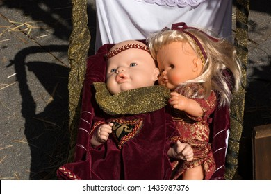 Pontevedra, Galicia/Spain - September 02 2017: Dolls with medieval costumes in a baby cart in the parade of the medieval fair called Feira Franca in Pontevedra (Spain)