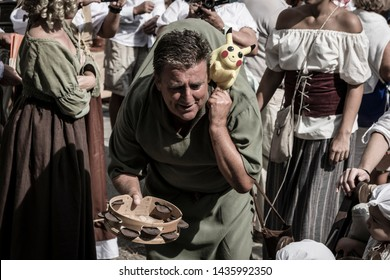 Pontevedra, Galicia/Spain - September 02 2017: Man disguised as a modern hunchback asking for alms during the parade of the medieval fair called Feira Franca in Pontevedra (Spain)