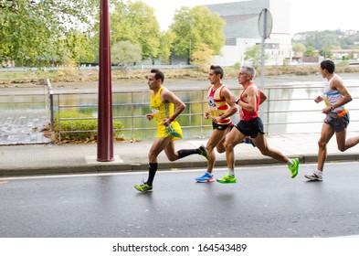 PONTEVEDRA - OCTOBER 20: Detail of the participants in the XVII Half Marathon held on the street circuit in the village of Pontevedra, on October 20, 2013.