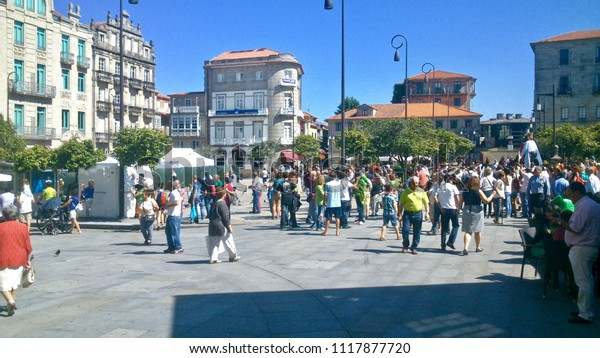 Pontevedra, Pontevedra / Spain - 08 16 2014: People walking on the centre of the city of Pontevedra in Galicia during a normal day of summer