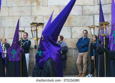 PONTEVEDRA, SPAIN - APRIL 3, 2015: Members of a religious brotherhood, wait for the start of the Holy Week processions.