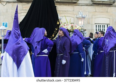 PONTEVEDRA, SPAIN - APRIL 3, 2015: Members of a religious brotherhood, parading during the Easter processions which runs through the city.
