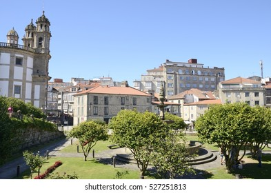 PONTEVEDRA, SPAIN - AUGUST 6, 2016: Church of the Pilgrim Virgin and other buildings in plaza in the city of Pontevedra, Galicia, Spain.