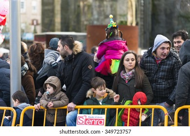 PONTEVEDRA, SPAIN - FEBRUARY 21, 2015: Spectators waiting for the parade of costumed stroll the streets of the city during the Winter Carnival.