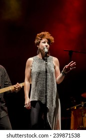 PONTEVEDRA, SPAIN - JULY 24, 2014: Detail of the free performance of jazz group, Robin McKelle and The Flytones, during the XXII International Jazz and Blues Festival held in the stret of the city.