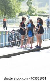 PONTEVEDRA, SPAIN - JUNE 11, 2017: Participants hope to compete in the Spanish Championship of Triathlon by clubs, celebrated by the streets and river of the city.