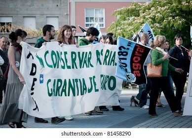 PONTEVEDRA, SPAIN - JUNE 11: Demonstration of ecologists for the closure of the pulp mill in the Ria of Pontevedra in Galicia, June 11, 2011 in Pontevedra, Spain.