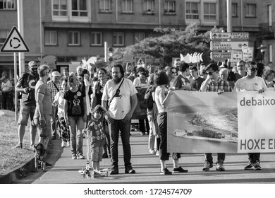 PONTEVEDRA, SPAIN - JUNE 16, 2018: Demonstration against the permanence of a paper pulp industry in a coastal area of the village, in the Ria de Pontevedra.