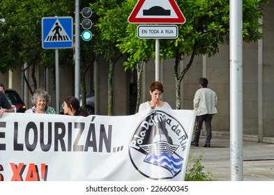 PONTEVEDRA, SPAIN - JUNE 21, 2014: Detail of ecological demonstration against the permanence of paper pulp industry in the Ria de Pontevedra.