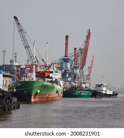 Pontianak, Indonesia - July 03, 2015: Harbor Cranes, Containers, and Boat in The Industrial Port in Pontianak