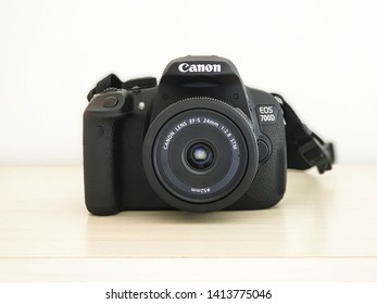 Pontianak, Indonesia-April 28, 2019: Picture of Canon EOS700D camera with Canon EF-S 24mm F/2.8 STM lens
