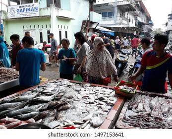 Pontianak, West Kalimantan/Indonesia - February 26th, 2018: Fish seller and buyer at Flamboyan market, Pontianak, West Kalimantan-Indonesia