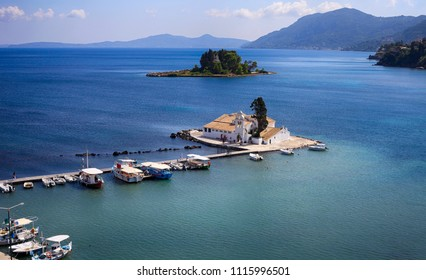 Pontikonisi and Vlacheraina Orthodox monastery seen from the hilltop of Kanoni on the island of Corfu, Greece.