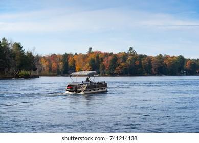 Pontoon Boat on Moon River in Muskoka