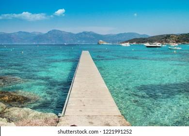 Pontoon at the Lotu beach, Agriates desert, Corsica - The Isle of Beauty, France