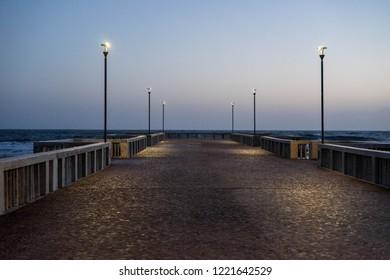 Pontoon over the sea in Ostia Lido, Roma, Italy