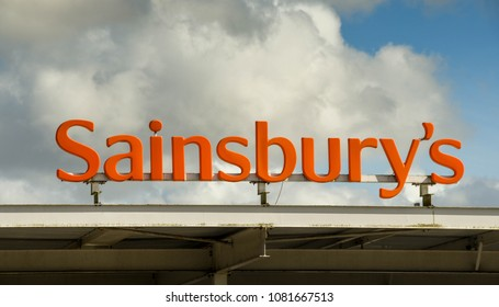 PONTYPRIDD, WALES - APRIL 2018: Large sign on top of a Sainsbury's petrol station