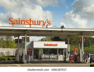 PONTYPRIDD, WALES - APRIL 2018: Signs on the roof and shop at a Sainsbury's petrol station