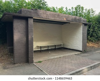 PONTYPRIDD, WALES - JULY 2018: An old bus shelter made of brick still in use on a road in Pontypridd, Wales.