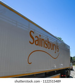 PONTYPRIDD, WALES - JUNE 2018: Branding of the supermarket Sainsbury's on the side of a delivery lorry