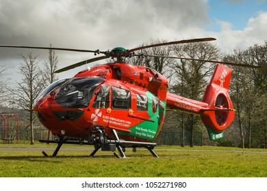 Pontypridd, Wales - March 2018: An Airbus EC145 helicopter of the Wales Air Ambulance service after landing in a park on an emergency call