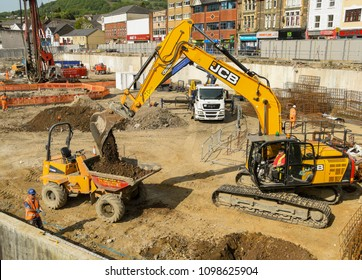 PONTYPRIDD, WALES - MAY 2018:  Excavator at work on the Taff Vale regeneration project, a major new mixed use development on the site for the former Taff Vale Precinct.