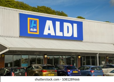 PONTYPRIDD, WLAES - APRIL 2018: Large sign on the front of an ALDI supermarket with cars parked outside