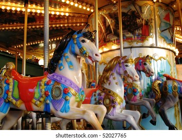 Pony rides on a merry-go-round carousel.