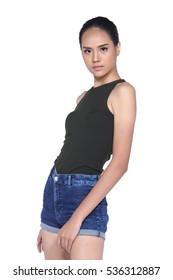 Ponytail hair girl in black vest open shoulders shorts jean high heels long legs, half body portrait pose in studio lighting white background, isolated