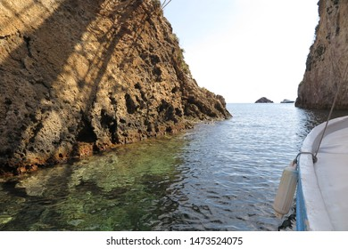 Ponza Island, Italy - August 2019:  Beautiful face of the Ponza Island and white and yellow rocks seen from the crystal clear blu and from the boat. Ponza,Italy