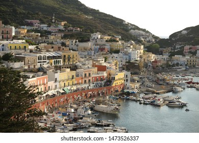 Ponza Island, Italy - August 2019: View of little harbor of Ponza island in the summer season with typical colored houses and boats. Ponza, Italy