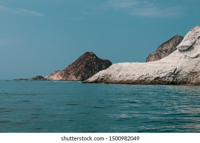 Ponza Island, Italy - August 2019: View of little harbor of Ponza island in the summer season with boats, cliffs and blue water.