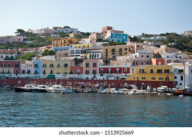 Ponza, Lazio / Italy - August 9 2019: port of the island of Ponza in the summer. The typical colored houses of the island of Ponza. Landscape of the harbor of island of Ponza.