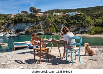 Ponza, Pontine Islands, Latina district, Latium, Italy - May, 05, 2017: Location bay of Cala Feola with people