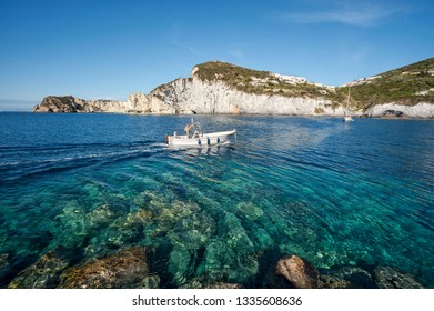 Ponza, Pontine Islands, Latina district, Latium, Italy - May, 05, 2017: Location bay of Cala Feola with tourists on the boat