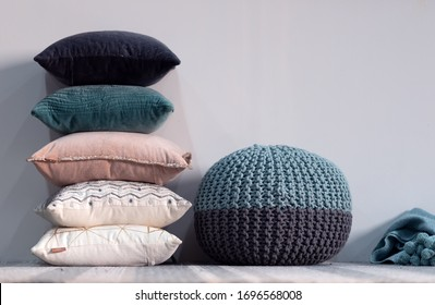 Poof & piled up cushions