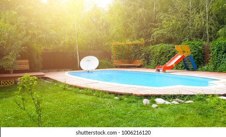 Pool in the backyard with a slide