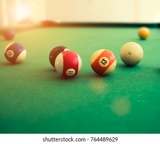 Pool balls on pool table;