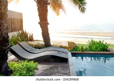 Pool Bed At Beachfront With Sun-flare