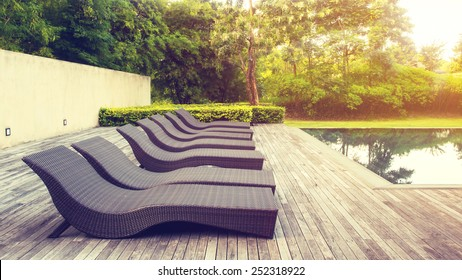 Pool beds on wooden ground with light in vintage style.