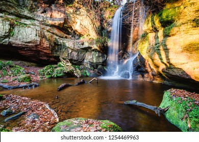 Pool below Roughting Linn Waterfall, which is well hidden in remote woodland, located in northern Northumberland, England and is also known as Routin Lynn Waterfall