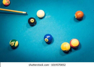 Pool Billiards Balls on the table with cue